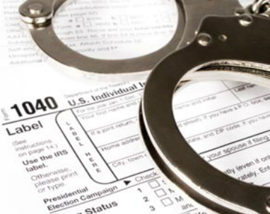 crime_tax fraud_hand cuffs