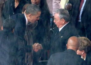 President Obama shakes hands with Cuban President Raul Castro during the official memorial service for former South African President Nelson Mandela at FNB Stadium