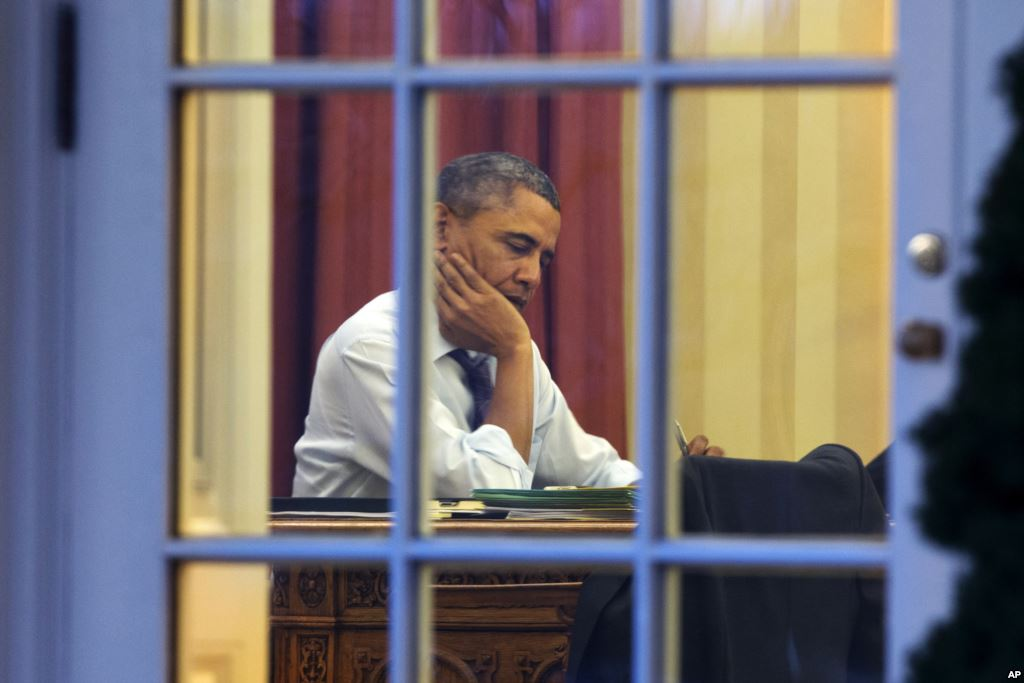 President Barack Obama works at his desk in the Oval Office. He has bold plans and is not waiting for Congress to act.