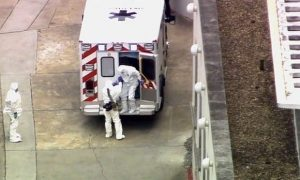 An ambulance arrives with Ebola victim Dr Kent Brantly, right, to Emory University hospital on Saturday.