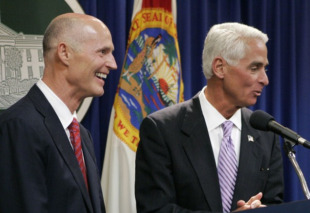 Florida Governor's race between Rick Scott (in the foreground) and Charlue Crist will be both nasty and expensive.