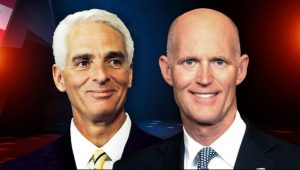 Charlie Crist and Gov. Rick Scott continue to battle in the race for the Governors Mansion